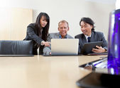 Business team working on laptop — Stock Photo
