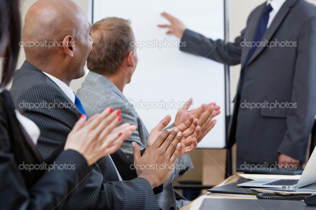 Business applauding after speech of a businessman at the conference — Stock Photo #7404895