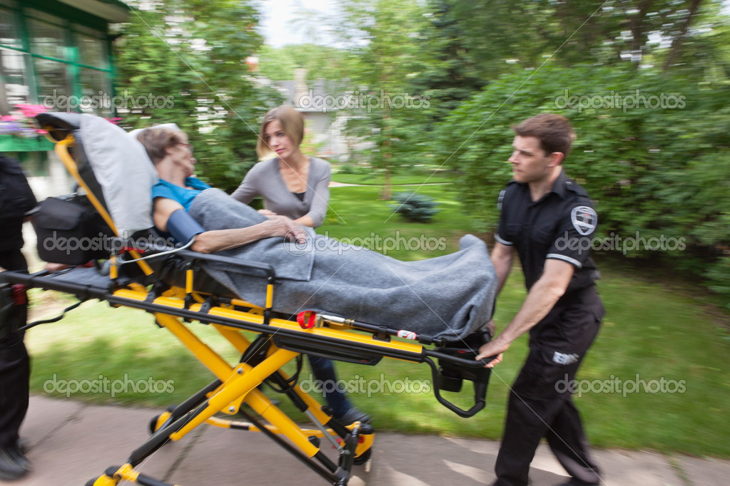 Senior woman being rushed to hospital on ambulance stretcher — Stock Photo #7409996