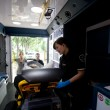 Stok fotoğraf: Ambulance Interior with Patient and Paramedic