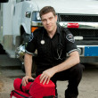 Paramedic with Portable Oxygen Unit - Stock Photo