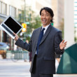 Businessman holding laptop and laughing — Stock Photo