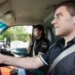 Paramedic with Radio in Ambulance - Stockfoto