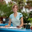 Greenhouse Employee - Stock Photo