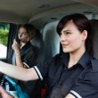 Female Paramedic Driving Ambulance - Stockfoto