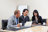 Business using tablet in meeting — Stock Photo