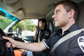Paramedic with Radio in Ambulance — Stock Photo