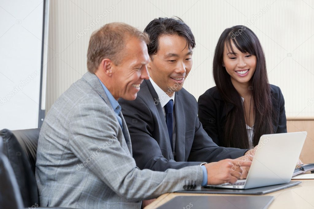 Diverse group of businesspeople working on laptop — Stock Photo #7410291