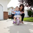Mother Teaching Son To Ride Bike — Stock Photo #7677005