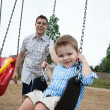 Father Pushing Son on Swing — Stock Photo