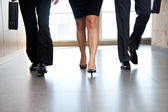 Businesspeople Moving Along Corridor — Stock Photo