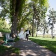 Стоковое фото: Newlywed Running Along Walkway