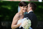 Man Kissing Wife on Cheeks — Stock Photo