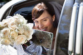 Happy Bride With Flower Bouquet — Stock Photo