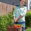 Happy Senior Woman with Fresh Vegetables — Stock Photo