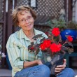 Senior woman holding potted plant — Stock Photo #7706651