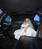 Bride Sitting in Limousine — Stock Photo