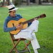 Handsome Man Playing Guitar - Stockfoto