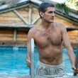 Man Coming Out of the Swimming Pool - Stock Photo