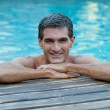 Man Relaxing by Pool's Edge — Stock Photo #7749014