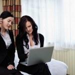 Two Businesswomen Sitting in Hotel Room — Stock Photo