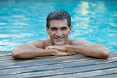 Man Relaxing by Pool's Edge — Stock Photo