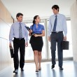 Stock Photo: Businesspeople Walking In Office Corridor