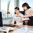 Two Female Executives Working In Office — Foto de stock #7756599