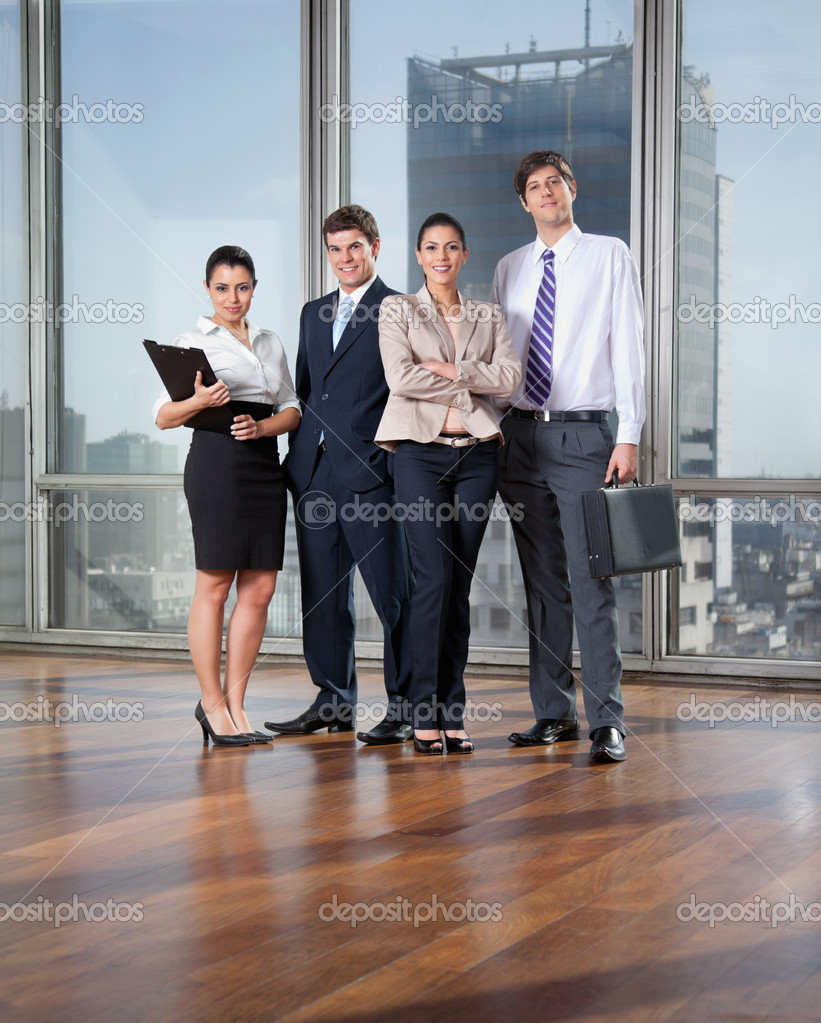 Full length of smart business executives posing — Stock Photo #7754416
