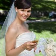 Newlywed Bride Holding Cell Phone — Stock Photo