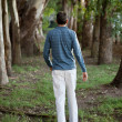 Man Walking Alone in Woods — Stock Photo