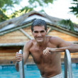 Smiling Middle Aged Man Standing in Pool — Stock Photo
