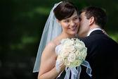 Happy Kiss of Newlyweds — Stock Photo