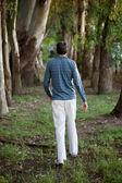 Man Walking Alone in Woods — Stock Photo