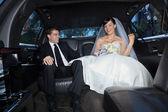 Happy couple in limousine — Stock Photo
