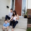 Stock Photo: Family Sitting on Steps