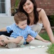 Mother and Son Playing with Sidewalk Chalk — Stock Photo