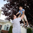 Father Lifting Son in Air — Stock Photo