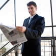 Businessman Holding Newspaper - Lizenzfreies Foto