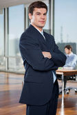 Confident Businessman Standing With Arms Crossed — Stock Photo