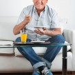 Senior Man Having Breakfast — Stock Photo #7943432