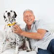 Senior Man Sitting With His Dog — Stock Photo #7943743