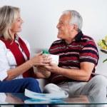 Smiling Senior Man Giving Gift to His Wife — Stock Photo