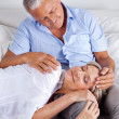 Wife Sleeping on Husband's Lap - Foto Stock