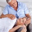 Foto Stock: Wife Sleeping on Husband's Lap