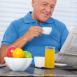 Senior Man Reading Newspaper — Stock Photo