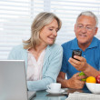 Man Showing Phone to his Wife — Stock Photo