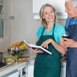 Couple with Recipe Book and Wine - Stockfoto