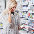 Woman in Pharmacy Talking on Phone — Stock Photo