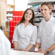 Pharmacists with Customer in Store — Stock Photo